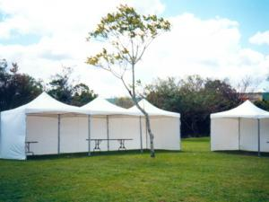 3m-x-3m-peak-top-marquees-in-a-row-creating-a-3m-by-9m-pavilion-with-9m-side-open
