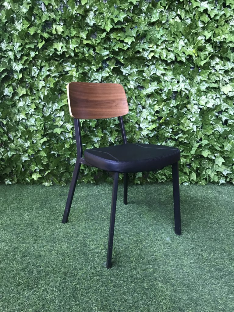 black-steel-frame-chair-with-vinyl-padded-seat-and-moulded-timber-back-rest