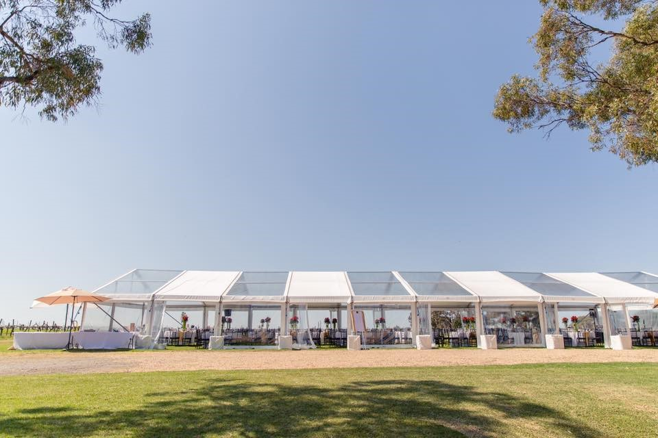 ten-meter-by-twenty-one-meter-pavilion-with-alternating-solid-white-vinyl-and-clear-roof-sections-with-opened-walls-for-an-event-in-Adelaide