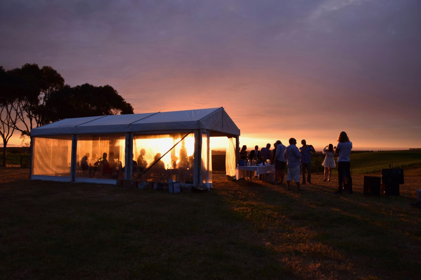four-by-nine-meter-solid-white-vinyl-roof-pavilion-with-clear-walls-at-sunset-in-surrounding-area-of-Adelaide
