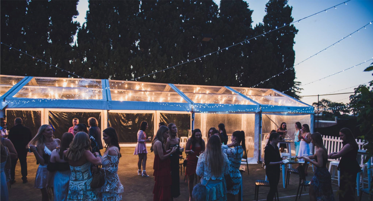 completely-clear-six-by-eighteen-meter-pavilion-with-festoon-lights-for-a-twenty-first-in-Adelaide