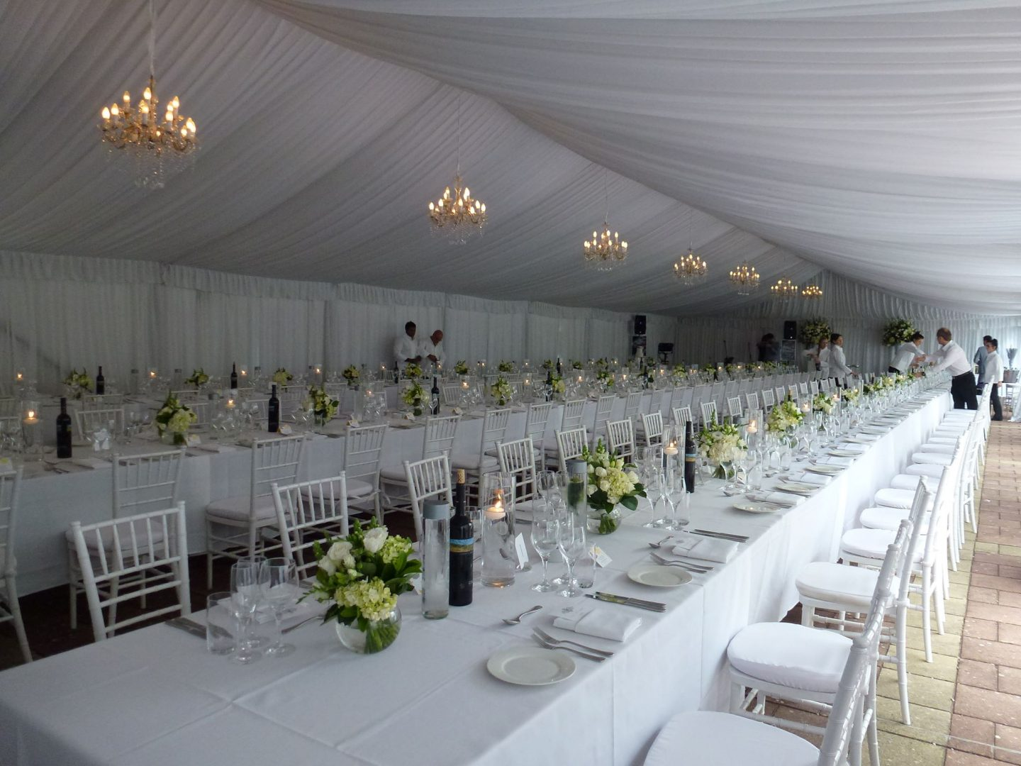 ten-by-twenty-four-meter-pavilion-fully-lined-with-white-draping-and-wedding-reception-set-up