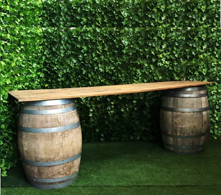 two-rustic-wine-barrels-with-a-3-meter-long-top-bar-for-serving-drinks-or-as-a-grazing-table
