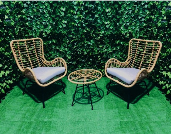 cane-outdoor-setting-with-two-cane-chairs-and-a-coffee-table-in-the-middle