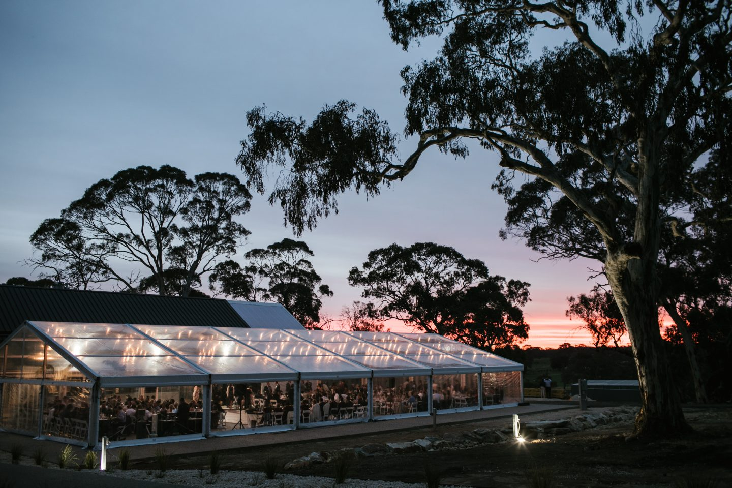 Hire-a-clear-pavilion-15-meters-wide-by-30-meters-long-at-lot-100-Adelaide-at-sunset-with-fairy-lights