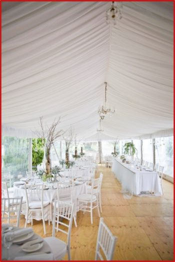 weddings with White Chiavari Chairs and Round Table