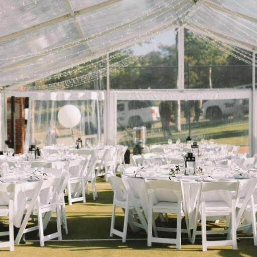 wedding-10m-x-30m-clear-pavilion-with-Americana-chairs-and-round-tables