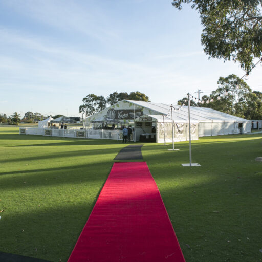 20m-pavilion-with-coopers-floral-gable-with-picket-fencing-and-outdoor-furniture-and-red-carpet-runner-entrance