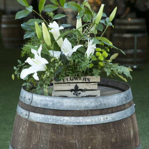 Rustic-Wine-Barrel-With-Flowers-on-top