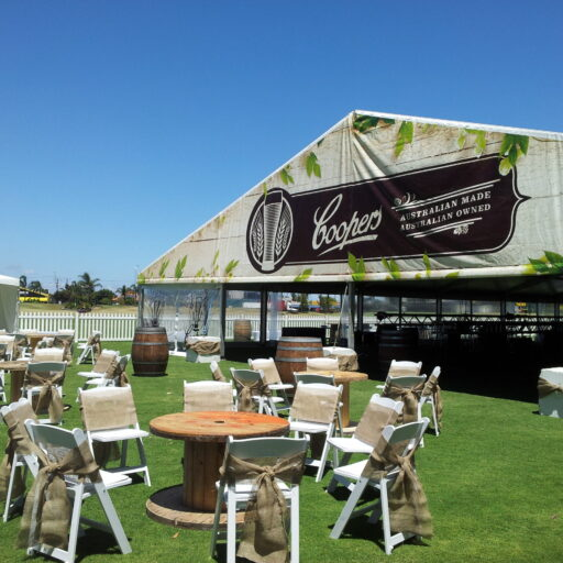 Front-area-of-coopers-retirement-party-with-white-americana-chairs-hessian-sashes-cable-tables-and-pavilion