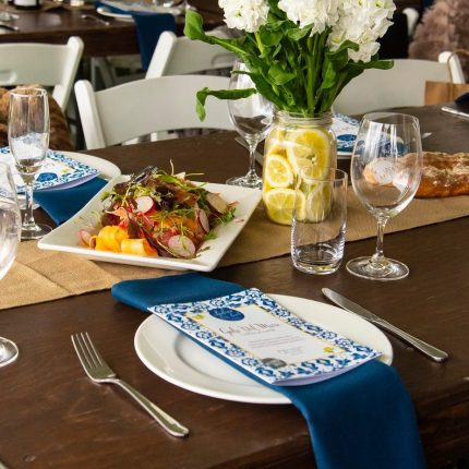 2019 Ladies Long Lunch - Stained Timber Tables, Navy Napkins and Hessian Runner Table Setting (2)
