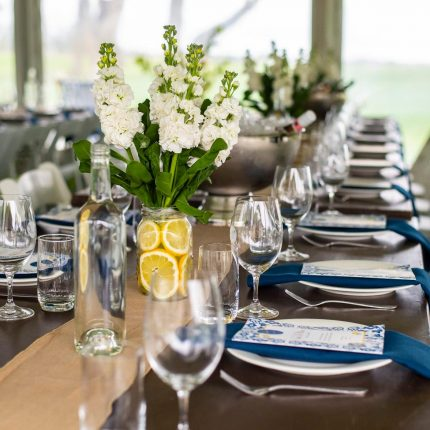 2019 Ladies Long Lunch - Stained Timber Tables, Navy Napkins and Hessian Runner Table Setting