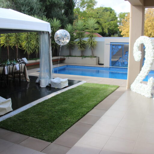 4m-x-12m-pavilion-with-walls-left-off-in-a-backyard-for-a-birthday-event
