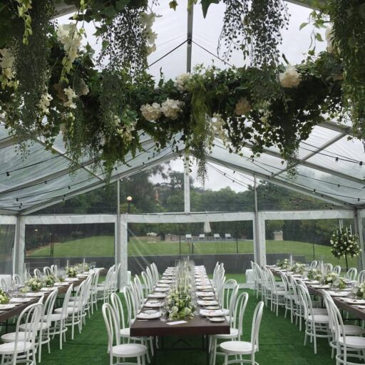 Wedding-10m-x-27m-clear-pavilion-with-Stained-Timber-Tables-and-White-Bentwood-Chairs