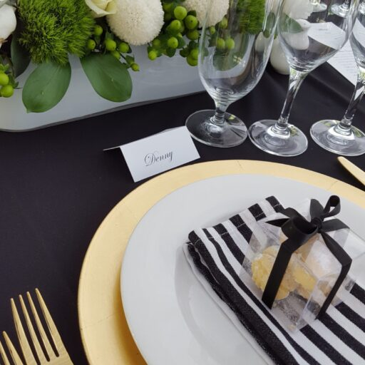 Wedding-at-beechwood-gardens-with-a-10m-x-18m-solid-toof-pavilion-with-Roof-Lining-Bentwood-Chairs-Black-Linen-and-Gold-Crockery-and-cutlery
