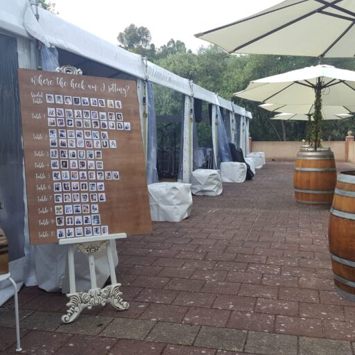 10m-x-21m-Pavilion-with-Clear-Walls-Wine-Barrels-with-White-Market-Umbrellas