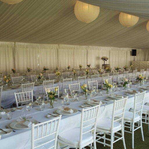 Wedding-with-10m-x-21m-pavilion-with-roof-and-wall-lining-Chiavari-Chairs-with-White-Cushion-White-Linen-Crockery-Cutlery-and-Glassware