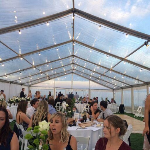 Clear-Pavilion-with-Americana-Chairs-Festoon-Lights-and-Feast-Watson-Flooring