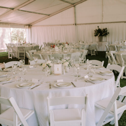 15m-x-25m-pavilion-with-Americana-Chairs-Round-Tables-White-Linen-and-Wall-Lining