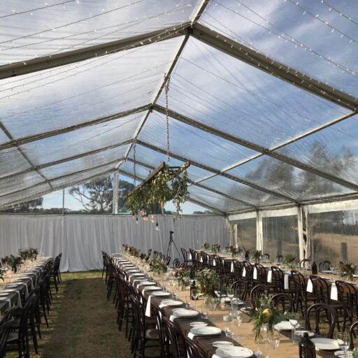 Port-Elliot-Wedding-Bubblewrap-Events-10m-x-24m-Clear-Pavilion-with-Stained-Timber-Tables-and-Bentwood-chairs
