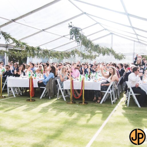 10m-x-21m-clear-roof-pavilion-with-long-tables-and-americana-chairs-for-a-private-birthday