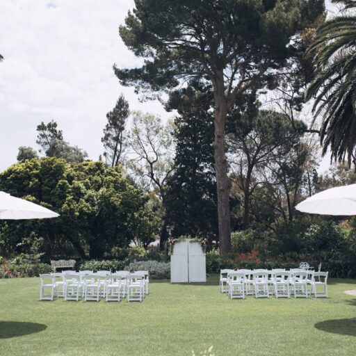Wedding-Ceremony-with-Americana-Chairs-and-White-Umbrellas-at-Beaumont-House