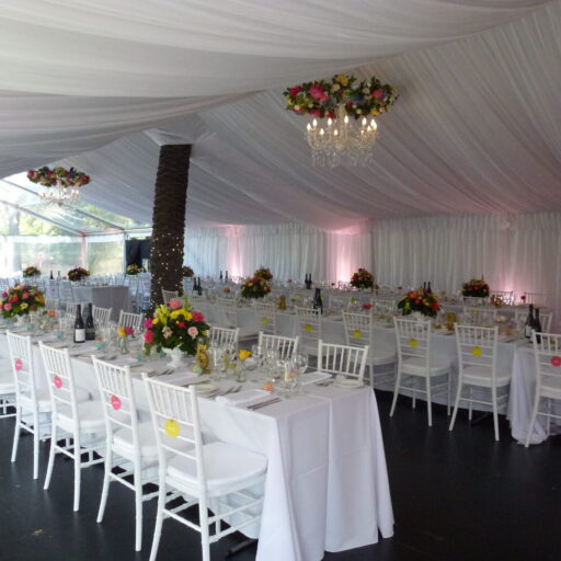 Wedding-at-Carclew-House-10m-x-18m-Pavilion-with-Black-Ply-Flooring-Wall-and-Roof-Lining-Chiavari-Chairs-White-Linen-and-Tableware