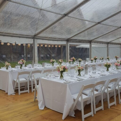 Wedding-Armoury-Lawns-10m-x-24m-Clear-Pavilion-with-Americana-Chairs-Trestle-Tables-with-White-Linen-and-Roof-Lighting