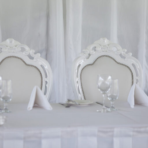White-Barouque-Wedding-Chairs-and-Glassware