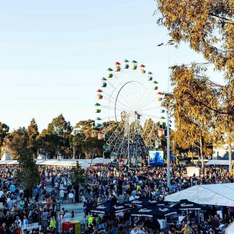 spin-off-festival-event-with-people-pavilions-and-ferris-wheel-for-major-event-gallery