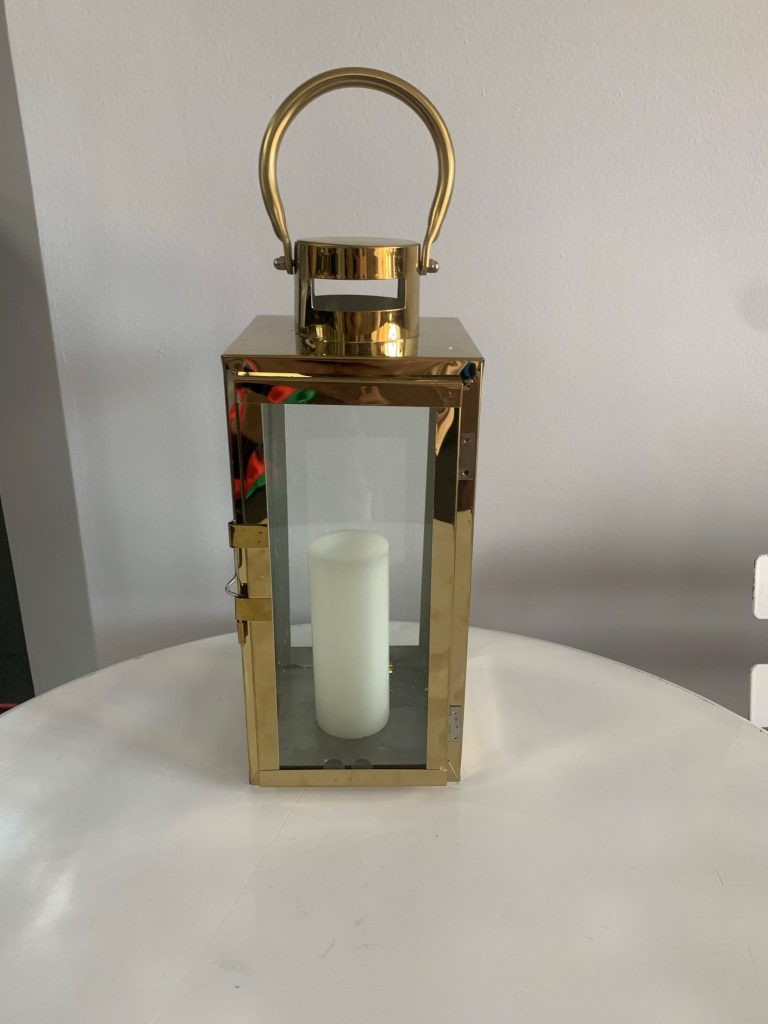 gold-framed-lantern-with-rectangular-glass-panels-and-carry-handle